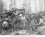 Crewmen from the Porcupine Gold Mining Company, standing in front of a donkey engine, Porcupine,...