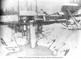 Porcupine Gold Mining Company flume station above pit No. 2 in the snow, Porcupine, Alaska, ca....