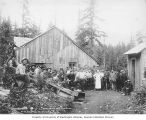 Crew from the Porcupine Gold Mining Company standing outside the camp mess house, Porcupine,...