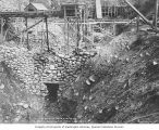 Pit No. 2 for the Porcupine Gold Mining Company showing temporary sluice box, Porcupine, Alaska,...