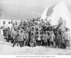 Group of native children in fur parkas outside of a school, Cape Prince of Wales, Alaska, ca. 1906