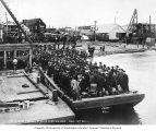 Passengers from the S.S. Ohio disembarking from a barge at a dock , Nome, Alaska, June 9, 1906