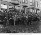 Group of men standing outside the Golden Gate Hotel, reception for Captain Roald Amundsen and...