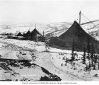 Mining dumps in the snow, Cleary Creek, Alaska, circa 1907