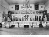 Interior of a Russian Orthodox Church showing the altar and chandelier, Unalaska, Alaska, ca. 1907
