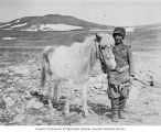 Russian miner standing with a horse, Saint Lawrence Bay, Siberia, ca. 1906