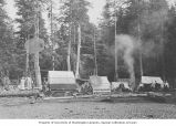 Native American village with tents and fire smoke, Admiralty Island, Gambier Bay, Alaska, ca. 1913