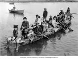 Eskimos from East Cape, Siberia in boat on Snake River, Nome, ca. 1906