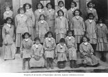 Group of Native American girls in school uniforms, Alaska, ca. 1913