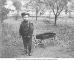 Earl Voorhies, son of Amos Earl Voorhies, with a wagon, Oregon, ca. 1900