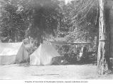 Man, two women and three children at a camp ground with two tents, Colestine, Oregon, ca. 1900