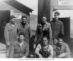 Shop crew standing outside of blacksmith and welding shops, probably at the U.S. Army or Naval...