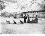 Dogsled team and sternwheel steamboat in Dawson, Yukon Territory, ca. 1900