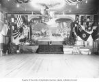 Decorated stage and ballroom in Dawson, Yukon Territory, July 14, 1912