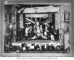 Palace Grand Theater stage scene with actors and orchestra portraying British imperial interests,...