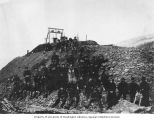 Group of men and women at a mining dump at claim no. 27 along Eldorado Creek near Dawson, Yukon...