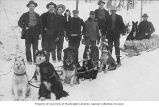 Group of men with dogsled team, possibly Yukon Territory, circa 1895-1897