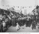 Crowd in street and grandstand celebrating July 4th, Fairbanks, Alaska, n.d.