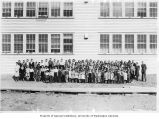 Children and teachers outside of school building, Nome, May 14, 1940