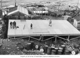 Children playing on wooden floor of uncompleted Health Center, Little Diomede, Alaska, ca. 1964