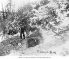 Two miners digging a mining shaft, probably Yukon Territory, ca. 1900