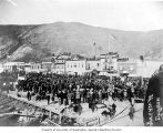 Crowd of people gathered along Front Street for a July 4th celebration, Dawson, Yukon Territory,...