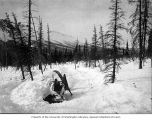 Campsite in snow along trail near Valdez, Alaska, ca. 1908