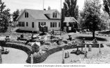 Rasmus Petersen's Rock Garden and house, located near Redmond, Oregon, ca. 1940-1950
