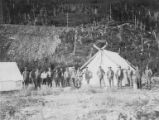 C. R. Breck's team of workers in front of tents at camp near Spencer Glacier, Alaska, circa 1914