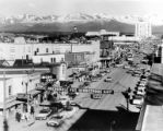 Looking down Fourth Avenue during the Fur Rendezvous festival, Anchorage, ca. 1956-1960's