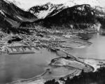 Aerial view of  Juneau with mountains in background, ca. 1957