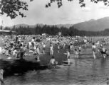 People at the beach near lake, Anchorage, circa 1950's-1960's