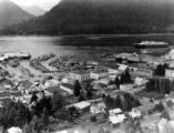 Aerial view of Petersburg, Alaska and harbor, ca. 1950s-1960s