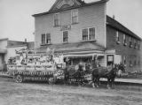 Girls on Goddess of Liberty float in front of Hotel Phoenix, Valdez, Alaska, July 4, 1910