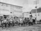Unidentified men on horses in front of the General Merchant store in Valdez, Alaska, ca. 1908