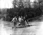 Berrying party crossing a river on a hand drawn ferry near Valdez, Alaska, August 1906