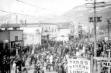 Crowded streets of Valdez, Alaska possibly during a July Fourth celebration, ca. 1910