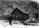 Packer Jack Newman in front of his cabin, Skagway, 1898