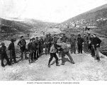 Group of men watching John Luther Stanley and Charley Worden boxing, Eldorado mine, ca. 1898