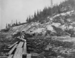 Tents of Alaska Engineering Commission Camp 84 above Turnagain Arm, with railroad construction in...