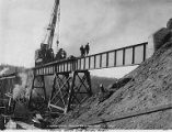 Crane in use to place north end of girder span on Hurricane Gulch Bridge on the Alaska Railroad,...