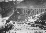 Alaska Railroad train entering Snowshed 54-B, probably on Seward Peninsula, Alaska, October 8, 1919