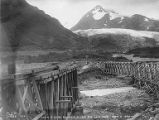 Old Alaska Northern Railway bridge and new Alaska Railroad bridge over Placer River, with glacier...