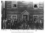 Group of men outside building, Dawson, ca. 1900