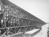 Trestle leading to Tanana River railway bridge, seen from north end, Alaska, October 27, 1922
