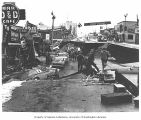 Earthquake damage to 4th Ave. near C Street, Anchorage, 1964