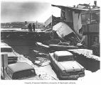 Earthquake damage to street and building, Anchorage, 1964