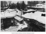 Earthquake damage showing houses and land deformation in the Turnagain neighborhood, Anchorage,...