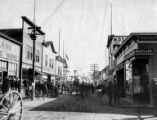 Nome street showing the Standard Theatre on the left, Alaska, circa 1910