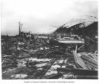 Earthquake damage to boats and docks, in Seward, 1964